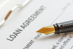 Loan agreement document with fountain pen